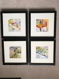 Set of four black small paintings