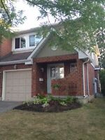 Fully upgraded contemporary end unit townhome.