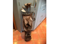 Set of old golf clubs