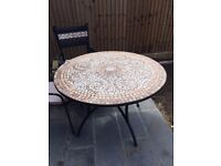 Lovely garden table and 4 chairs, too big for my garden. Good condition.