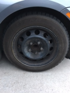 Goodyear Nordic snow tires with rims