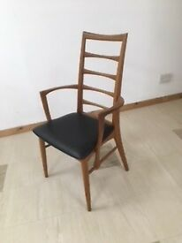Classic 1960's Danish designer teak chair with arms.