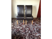 pair leather look dining chairs
