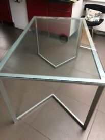 Contemporary glass dining table in good condition
