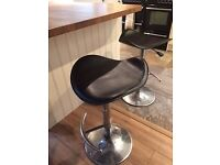 4 gas bar stools. Black leather look seat
