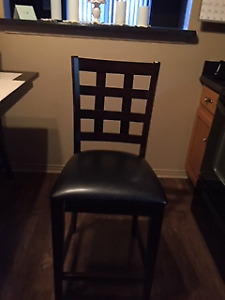 2 Counter Height Kitchen Chairs - Black Vinyl with Wood Frame.
