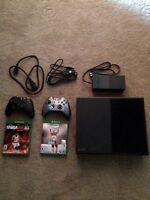 Xbox One- Includes 2 Games & 2 Controllers