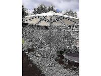 **GARDEN PARASOL**COMES WITH CAST IRON BASE**BARGAIN**NO OFFERS**