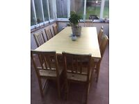 Large pine extendable dining table and 10 matching pine chairs