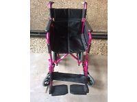 Black & pink wheelchair