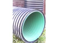 two large tubes approx 1.8 mtres long x 24'' diam