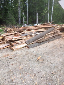 Log slab cuts for corals or fencing