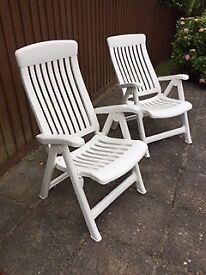 White plastic Reclining Chairs with Cushions