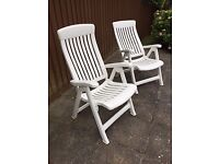 White plastic Reclining Chairs withCcushions