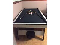 6ftx3ft Pool table including full set of balls and 2 cues. Very good condition. Quick sale