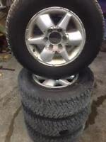 SET OF 4 255 65 R16 WINTER TIRES AND RIMS FOR SALE