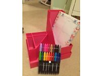 Pink desk organisers with weekly planner and marker pens