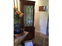 Glass fronted lockable corner cabinet with key