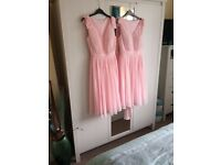 Two pale pink knee length bridesmaids dresses (UK sizes 12 and 14)