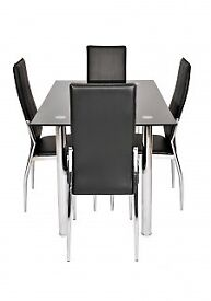Excellent condition Black glass dining table and four chairs for sale