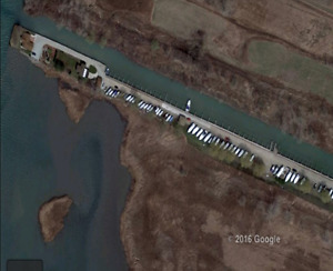 MARINA FOR SALE (Approx. 7 ACRES) 105 BOAT SLIPS w/WORKSHOP