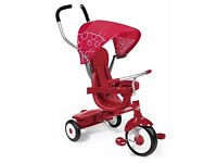 Red Radio Flyer 4-in-1 tricycle 9 months-5 years with orginal box