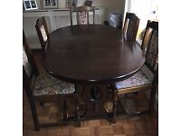 Dining Table with 6 chairs, 2 have arms. Table has a small water mark on the top.