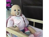 Baby Annabell doll and outfits and John Lewis dolls cradle