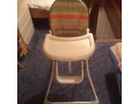 Folding mamas and papas high chair with safety harness