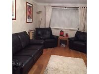 Dark brown leather 3-piece suite - 3-seater sofa, recliner and armchair. Immaculate condition.