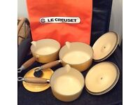 Le Creuset set of three saucepans and lids