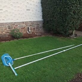 Swimming pool net with extension pole. Immaculate condition