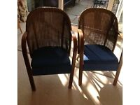 Two Lloyd Loom type armchairs
