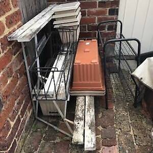 Vintage tiered plant stand and numerous plastic pots