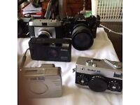 Assortment of vintage 35 mm cameras for sale