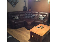 Corner leather reclining couch and storage stool