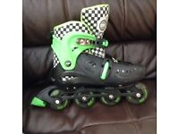 In line skates. adjustable size 4-7 with knee, elbow ankle pads and gloves.vgc In Penwortham.