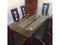 Glass dining table with 6 faux leather chairs