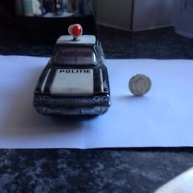toy tin police car with moving lamp