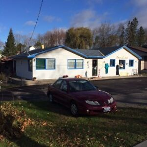 COMMERCIAL WITH STUDIO APARTMENT LOCATED RIGHT ON HWY #7