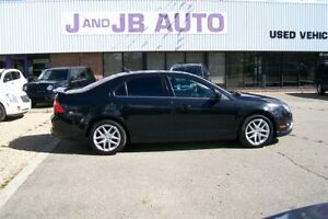 Heated seats ** 2010 FORD FUSION AWD *** All Credit Approved ***
