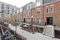 REDUCED!!! 2-storey townhouse with SKYLINE patio and PARKING