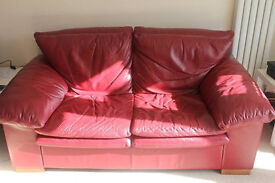 Deep red 2 seater leather sofa