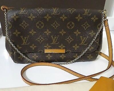795a5c23ba84 Louis Vuitton - The Favorite MM clutch in Monogram canvas