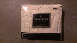 Ivory colored Size FULL satin bed sheets.