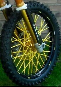 New never installed yellow spoke covers