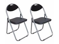 Brand new with tags on folding chairs-- pack of 2