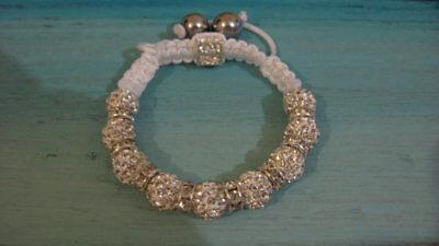 (Silver bracelet, handmade hematite and crucifix detail, costume jewellery)