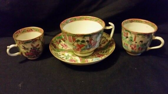 Three canton famille rose cups together with similar saucer