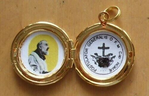St Padre Pio relic locket, high polished gold toned relic locket w/ prayer card!